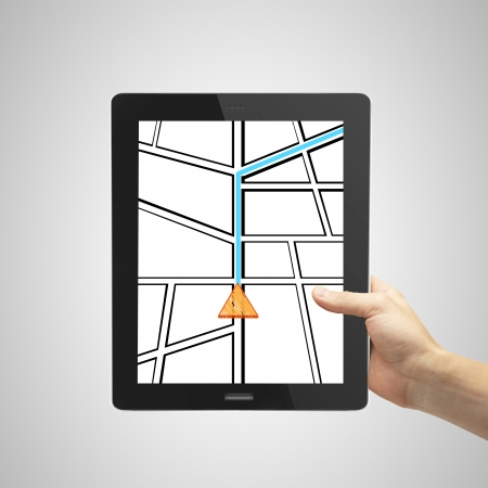 hand holding touchpad with drawing map photo