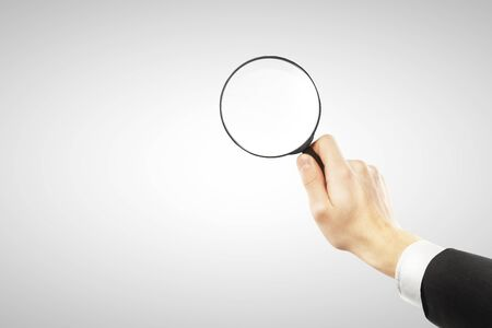 lens in hand  on a white background Stock Photo - 16292422