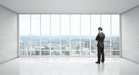 back of head: white loft mansarda and businessman