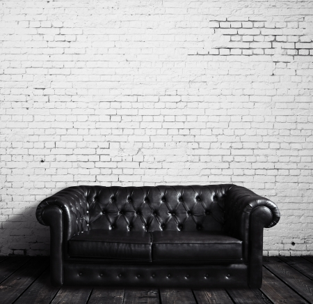 concrete blocks: leather sofa in brick room