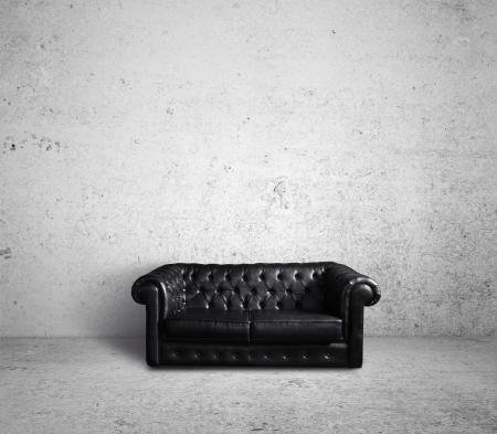 divano: divano in pelle nella stanza di cemento