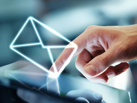 hand touching digital tablet and mail symbol Stock Photo - 16292796