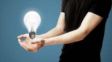 singn: man with lightbulb on blue background