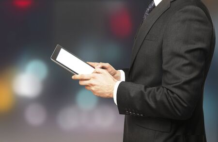 man holding tablet on blured background Stock Photo - 16292785