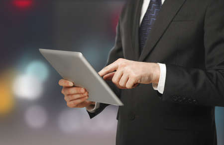 man pushing tablet on blured background Stock Photo - 16292731