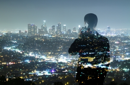 businessman with phone looking in night city photo