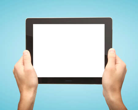 hands holding tablet on blue background Stock Photo - 16292463