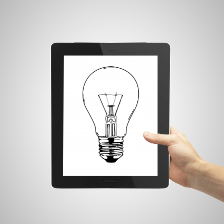 hand holding tablet with lightbulb photo