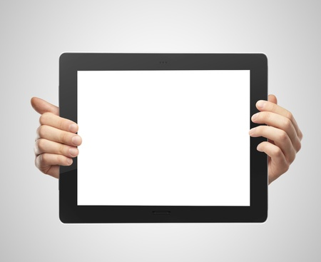 hands holding tablet on gray background Stock Photo - 16292391