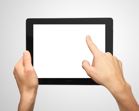 tablet pc in hand: hands pushing tablet on gray background Stock Photo