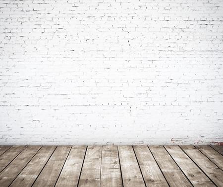 muro di mattoni e pavimento in legno Archivio Fotografico