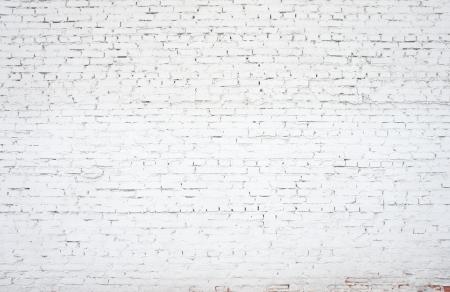 white brick wall: white old brickwork closeup, backgrounds Stock Photo