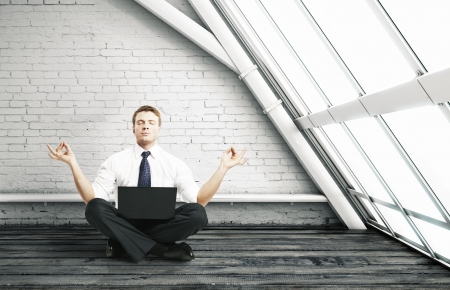 businessman meditation in room with big window Stock Photo - 16343191