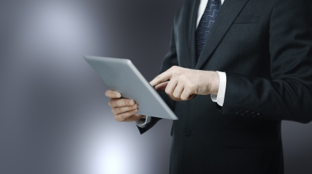 blured: man pushing tablet on blured background Stock Photo