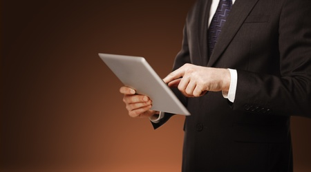 businessman pushing tablet on blured background Stock Photo - 16342598