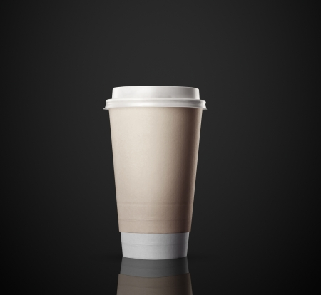 disposable cup: Paper cup of coffee isolated on black background Stock Photo