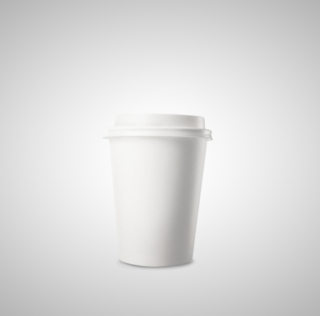 disposable cup of coffee on gray background photo