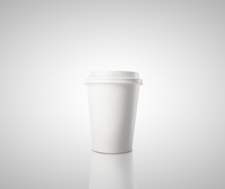 Paper cup of coffee on gray background photo