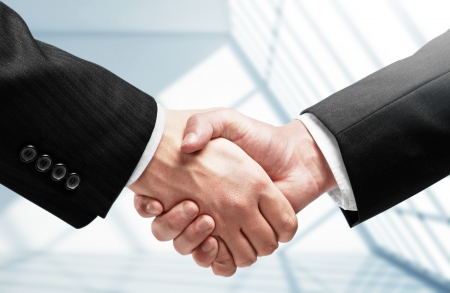 handshake on a room background photo