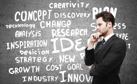 man choosing business tags on wall Stock Photo - 16343357