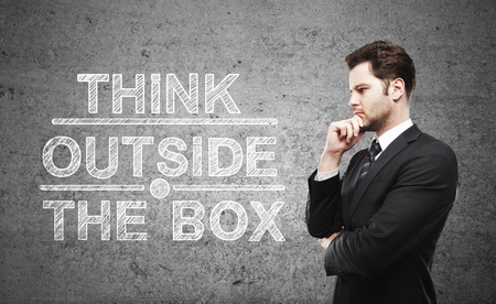 thinking outside the box: businessman thinking and think outside the box Stock Photo