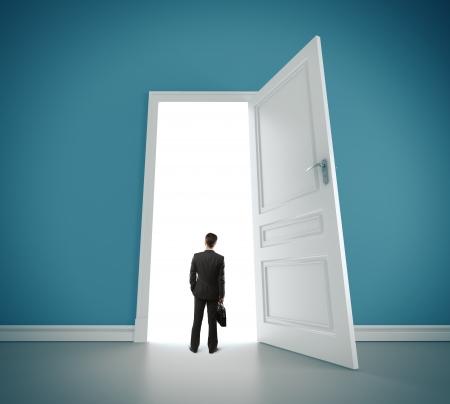 man in blue room with doors open photo