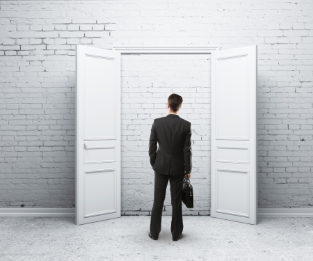 man in brick room with open door Stock Photo - 16343398