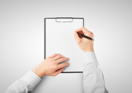 man drawing on clipboard on white background photo