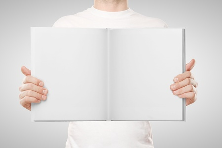 man holding book on white background Stock Photo - 16343238