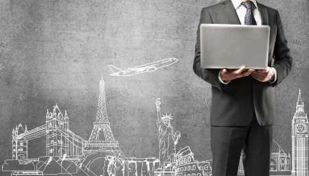 business travel: man holding notebook travelling concept