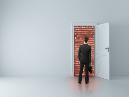 walled: businessman in blue room with walled door
