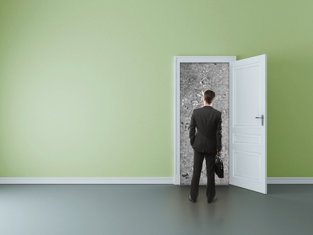 man in room with walled door Stock Photo - 16343224