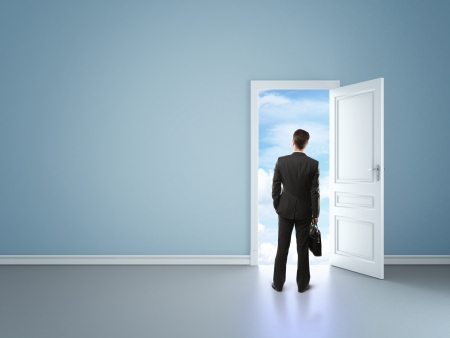 businessman in blue room with door in sky photo