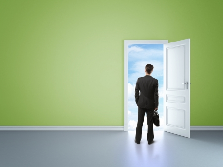 blue sky thinking: man in green room with door in sky