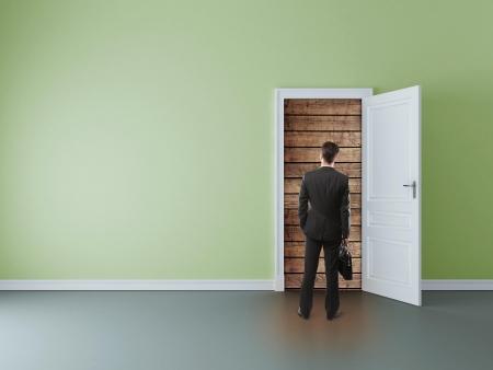 walled: man in room with walled door