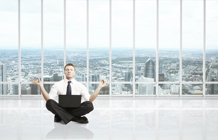 businessman meditation in room with big window Stock Photo - 16343232