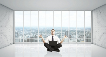 man meditation in room with big window Stock Photo - 16343252