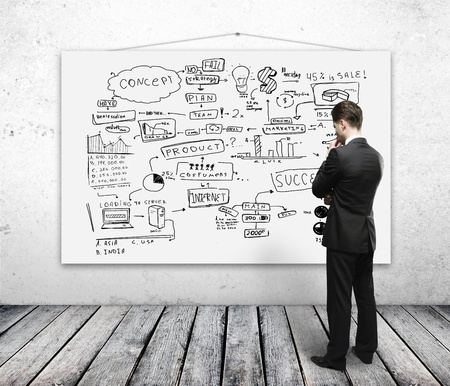 man looking poster with business plan Stock Photo - 16343406