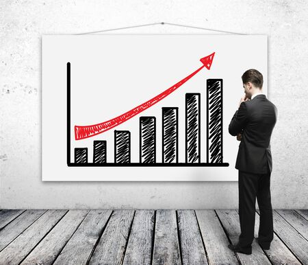 man looking poster with growth chart photo