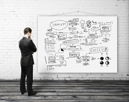 man looking poster with business strategy Stock Photo - 16343279