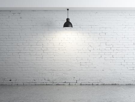 witte bakstenen kamer en lampen Stockfoto