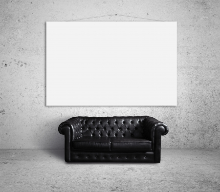 sofa in room and poster on wall photo