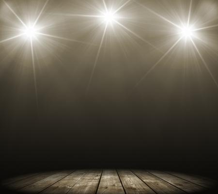 perform: concert spot lighting over dark background