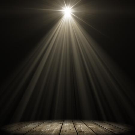 stage spot lighting over dark background photo