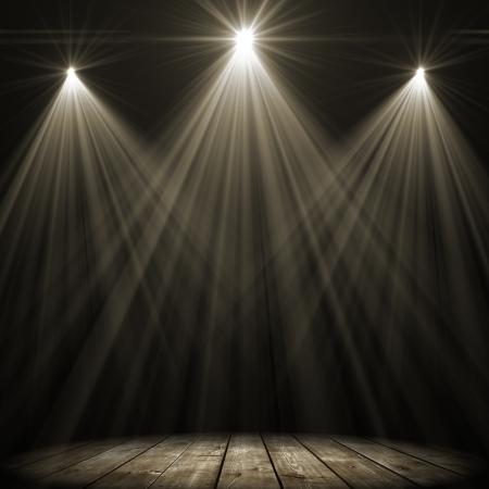 three stage spot lighting over dark background photo