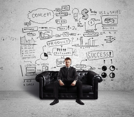 businessman sitting on couch and Global Concept Wall photo
