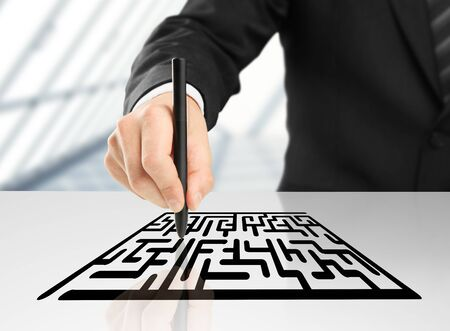 businessman drawing labyrinth on a white background Stock Photo - 16698034