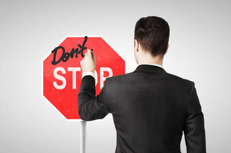 taxman: businessman drawing a dont stop sign Stock Photo