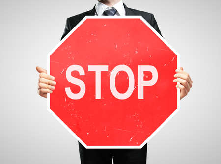 taxman: businessman holding a stop sign Stock Photo