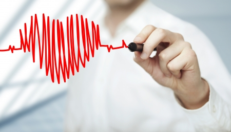 heart rate: businessman drawing heart and chart heartbeat